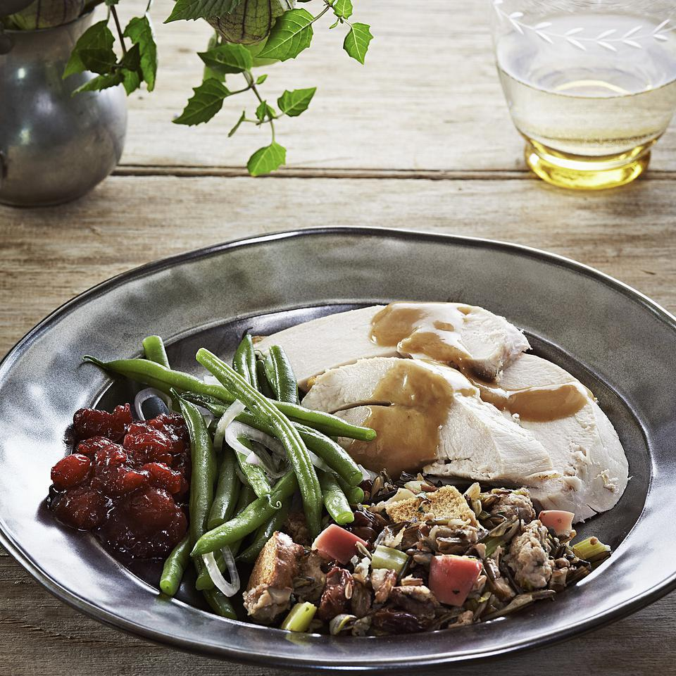 "This roast turkey recipe is flavored with sage and served with gravy made extra-tasty with the lemony pan drippings from the turkey and bay leaves in the giblet stock. The salt rub in this recipe acts as a ""dry brine,"" plumping and seasoning the meat for moist, juicy, flavorful turkey."