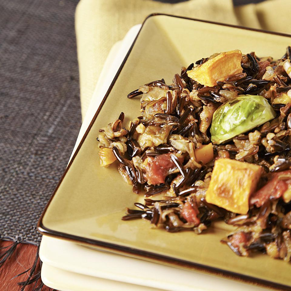Wild rice is intensely aromatic so it's a great match for the bold flavors of saffron and Madeira in this wild rice pilaf recipe. Roasted sweet potatoes and Brussels sprouts studded on top give it a festive look and help make it filling enough for a vegetarian main dish.