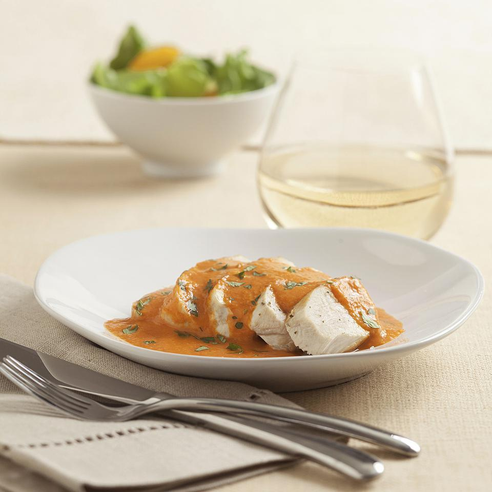 In this healthy chicken with red pepper cream sauce recipe, roasted red pepper and chipotle give this creamy sauce a beautiful red hue and give it a slightly sweet and smoky flavor. The sauce can be made ahead, then served with seared chicken, as we do in this recipe, or with grilled fish or ravioli. This recipe makes more Cream Sauce without the Cream than you'll need for the red pepper sauce. Refrigerate or freeze the extra sauce and use it in place of heavy cream in any sauce or soup that calls for cream.