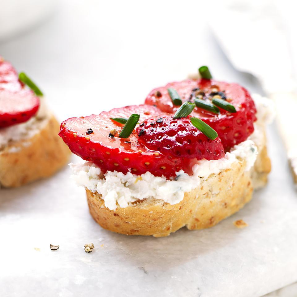 In this healthy bruschetta recipe, the big, bold, salty, tangy flavor of blue cheese makes an unexpected but utterly delicious match with sweet juicy strawberries. This bruschetta recipe makes a quick, easy appetizer and is so pretty topped with chopped green chives.