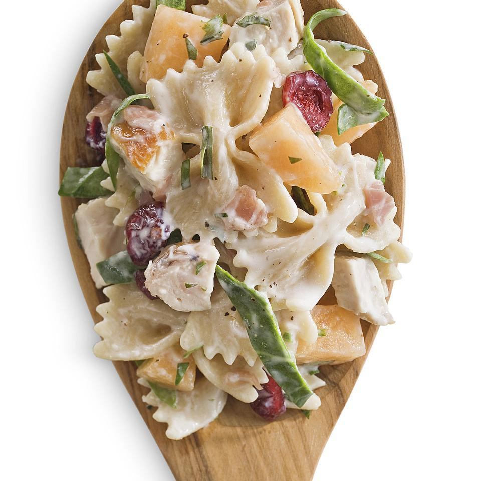 Melon, prosciutto and dried cranberries pair well together in this chicken pasta salad recipe. Fresh grilled chicken breast is best, but you can save time by using roasted or grilled chicken from the supermarket. For the best flavor, combine the pasta salad with the dressing about 1 hour before serving.Source: EatingWell Magazine, May/June 2013