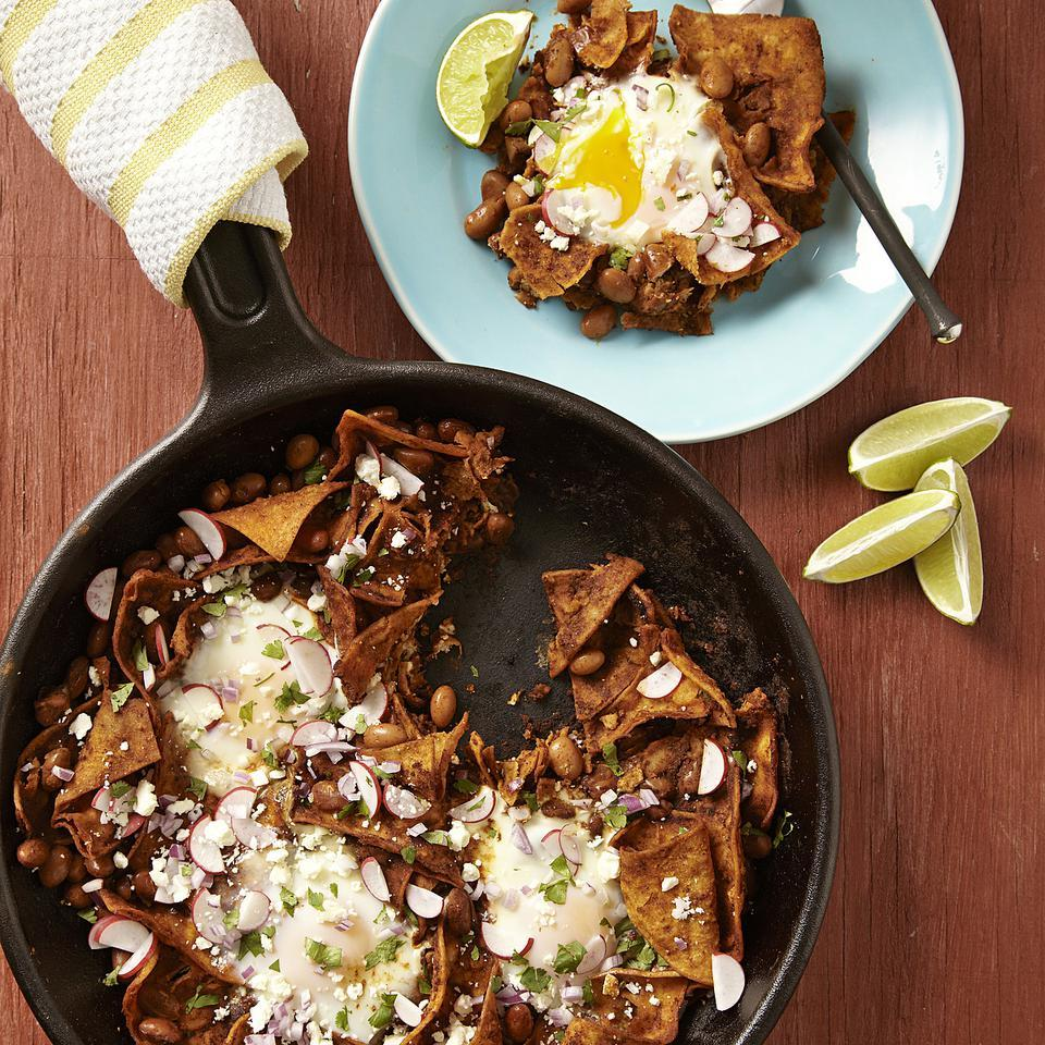 This Mexican chilaquiles recipe is a one-skillet dish made with corn tortillas and eggs. Making chilaquiles is a great way to use stale tortillas, as they are crisped in the oven before being simmered in a flavorful garlicky sauce. Unless you want a very spicy sauce, make sure to use regular (not hot) chili powder. Source: EatingWell Magazine, May/June 2013