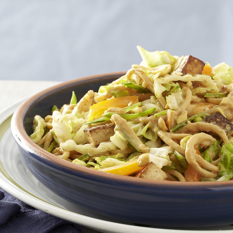 Top this vegetarian noodle salad recipe, which is tossed with loads of veggies and ample peanut sauce, with chopped roasted peanuts for added crunch and protein. Source: EatingWell Magazine, July/August 2013