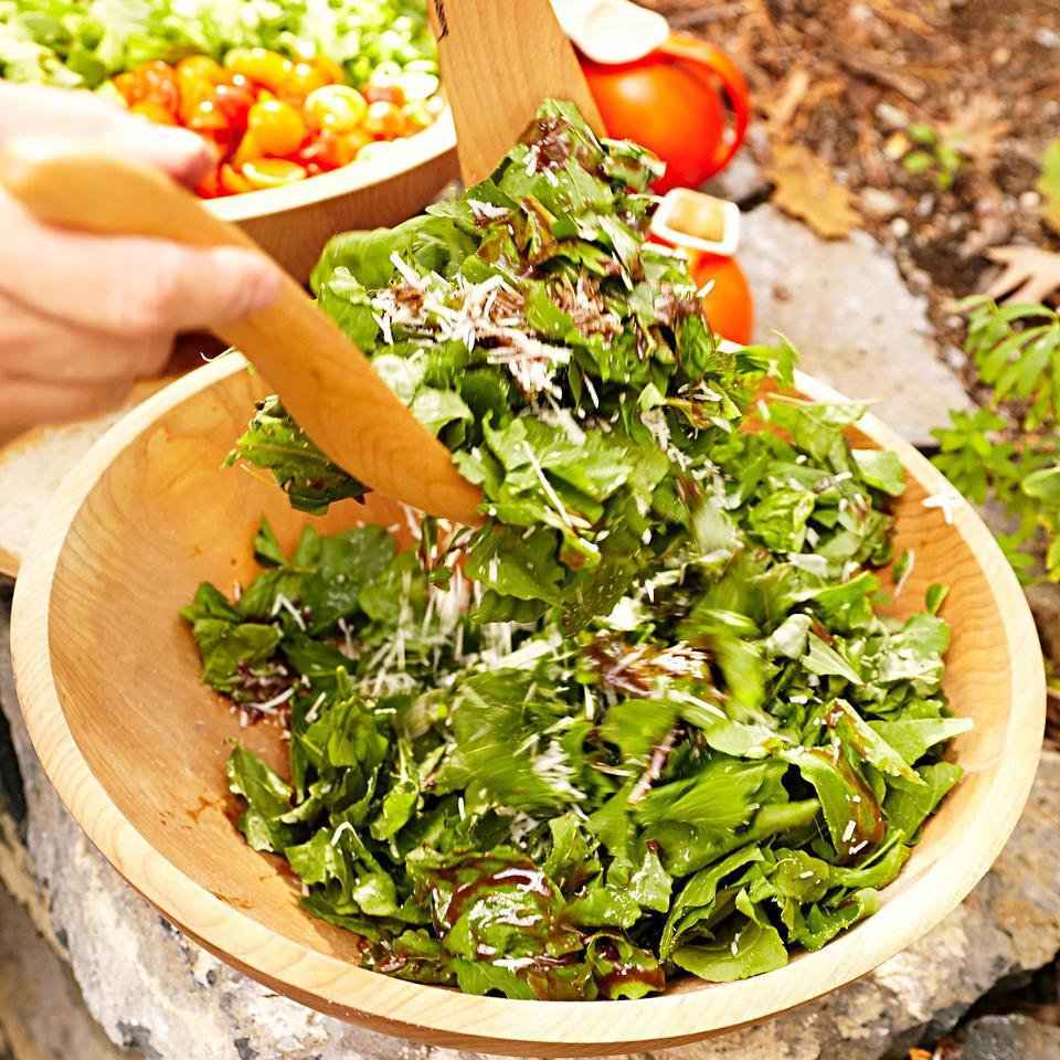 This light basil, parsley and arugula salad recipe is tossed with a tangy balsamic vinaigrette. It's great with pizza or as a light side salad.