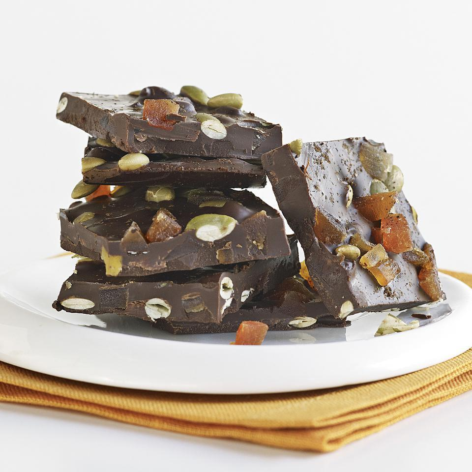 With just a few simple steps, you can transform plain chocolate into a divine treat with this chocolate bark recipe. We stir dried papaya, pepitas and chile powder into this chocolate bark, which is perfect for a gift.