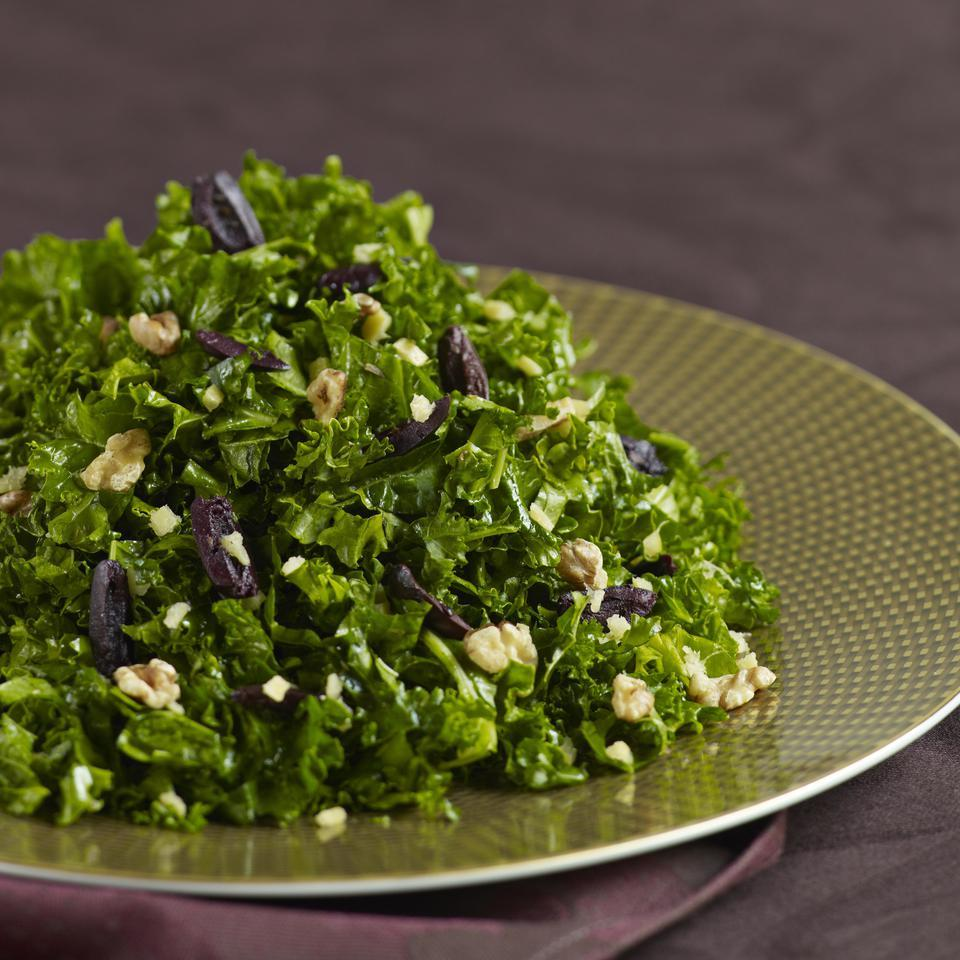 In this kale salad recipe, we massage dressing into the kale leaves until they're tender and coated with flavor. Topped with bold Mediterranean flavors--olives, walnuts and preserved lemons--this healthy salad is as delicious as it is nutritious. Look for preserved lemons at specialty-foods shops or online at surlatable.com. Or, to make your own, see the recipe on eatingwell.com.