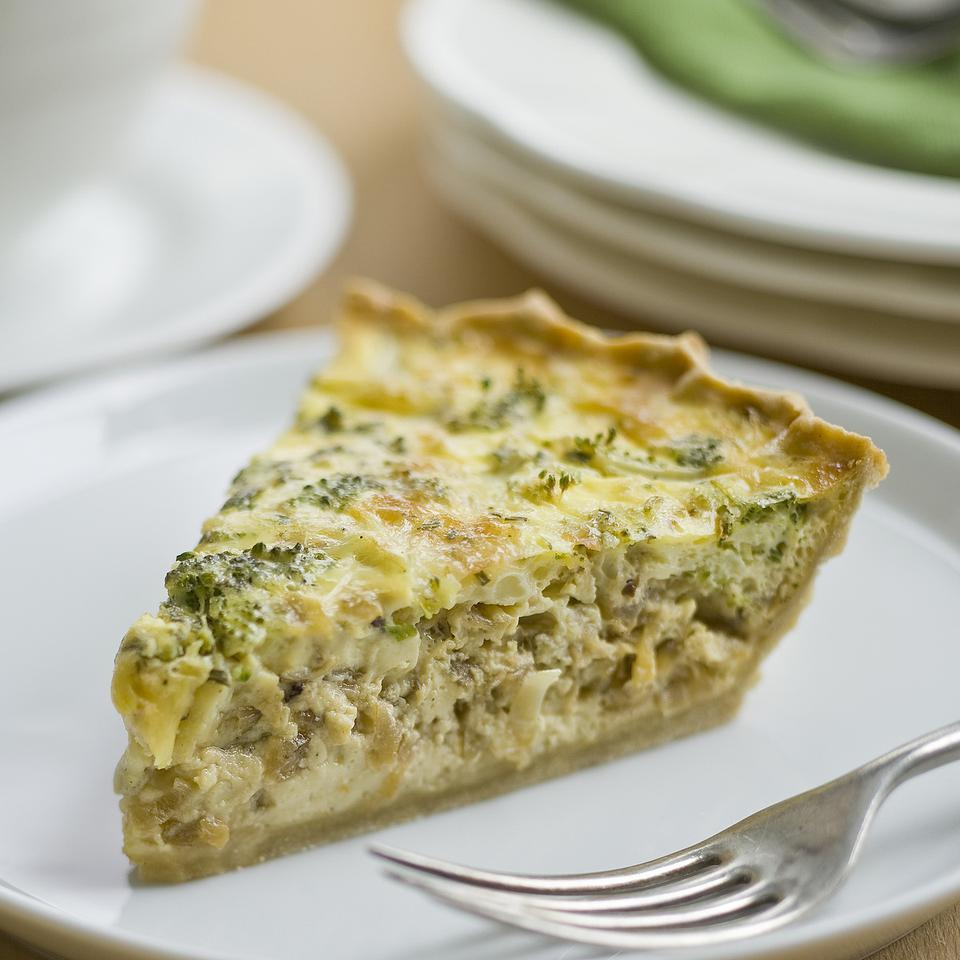 This healthy quiche recipe is perfect for entertaining—the quiche can be made ahead and is just as flavorful served warm or at room temperature. Filled with broccoli, fresh rosemary, Cheddar cheese and caramelized onions, this healthy quiche with a whole-grain crust is perfect for breakfast or brunch, or served with a light salad for lunch.
