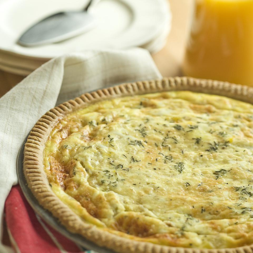 This healthy quiche recipe is perfect for entertaining--the quiche can be made ahead and is just as flavorful served warm or at room temperature. Filled with caramelized onions and Parmesan cheese, this healthy quiche with a whole-grain crust is perfect for breakfast or brunch, or served with a light salad for lunch.