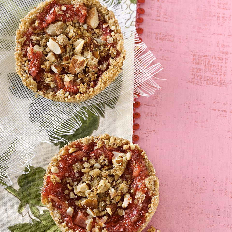 This muffin-tin recipe for strawberry-rhubarb pies is cute as can be and delicious too! These mini strawberry-rhubarb pies have a special crust made from almonds and white whole-wheat flour. Make sure you let the baked pies cool in the pan for the full 30 minutes so the filling has time to set. Serve with fresh whipped cream or a dollop of Greek yogurt.