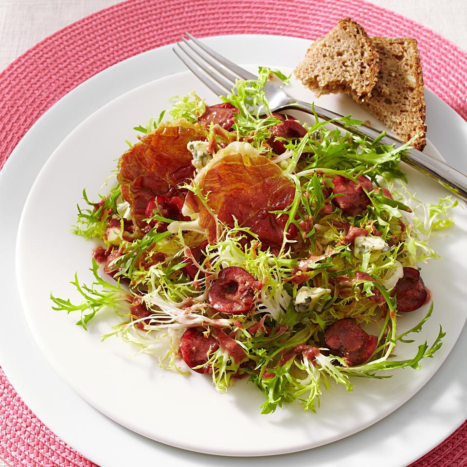 Sweet cherries, earthy blue cheese and salty prosciutto balance each bite in this healthy side salad recipe. If you can't find frisée, curly endive is a good alternative.