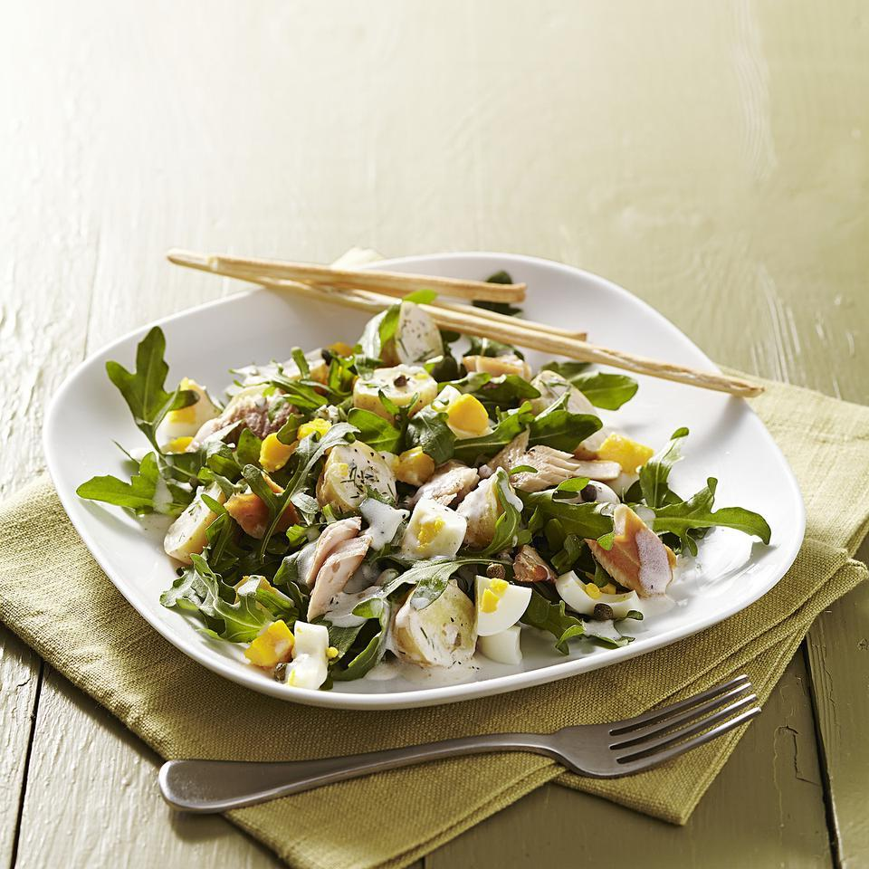 In this sophisticated dinner salad recipe, tender, new potatoes and early summer arugula add a dynamic duo of creamy and peppery texture and flavor to the smokiness of the trout. You can hard-boil the eggs ahead of time, but in a pinch, just add them into the pot with the cooking potatoes. They're just as tasty served warm in this salad.
