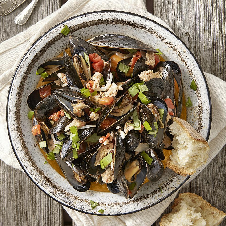 When mussels and turkey sausage meet up with white wine and tomato, pure kitchen alchemy occurs in this quick dinner recipe. The broth that brews at the bottom of the pot will make you feel that a piece of crusty bread (for soaking, of course) is your new best friend. Source: EatingWell Magazine, July/August 2014