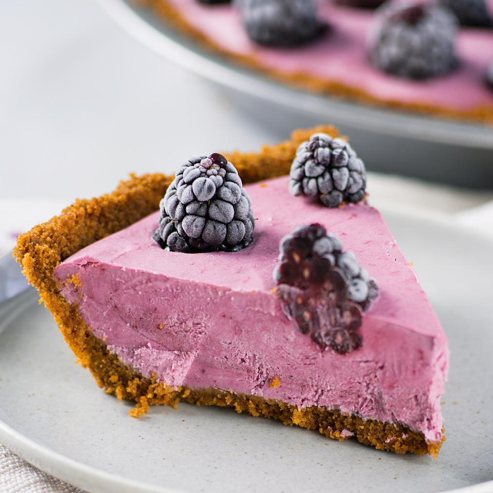 In this healthy ice cream pie recipe, crumbled gingersnaps make an easy and tasty crust for the blackberry and lemon filling made with nonfat vanilla Greek yogurt.