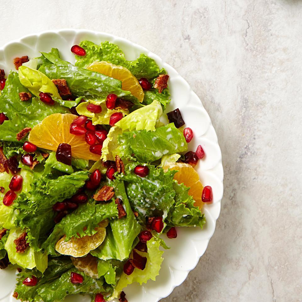 Jewel-like pomegranate seeds star along with bacon, tangy clementines and sweet dates in this mixed green salad recipe. To make it a dinner salad, top with chicken, shrimp or pan-seared salmon.