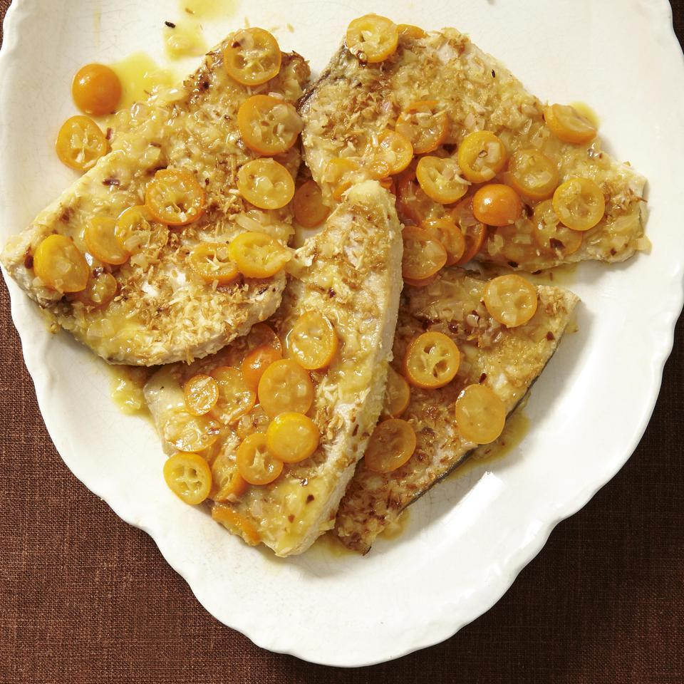 This coconut-crusted swordfish is served with a delightfully tart sauce made with kumquats--tiny citrus fruit that you can eat whole, including the skins and seeds. For an extra hint of coconut flavor, sear the fish steak in coconut oil. Serve with brown rice and glazed carrots. Source: EatingWell Magazine, November/December 2014