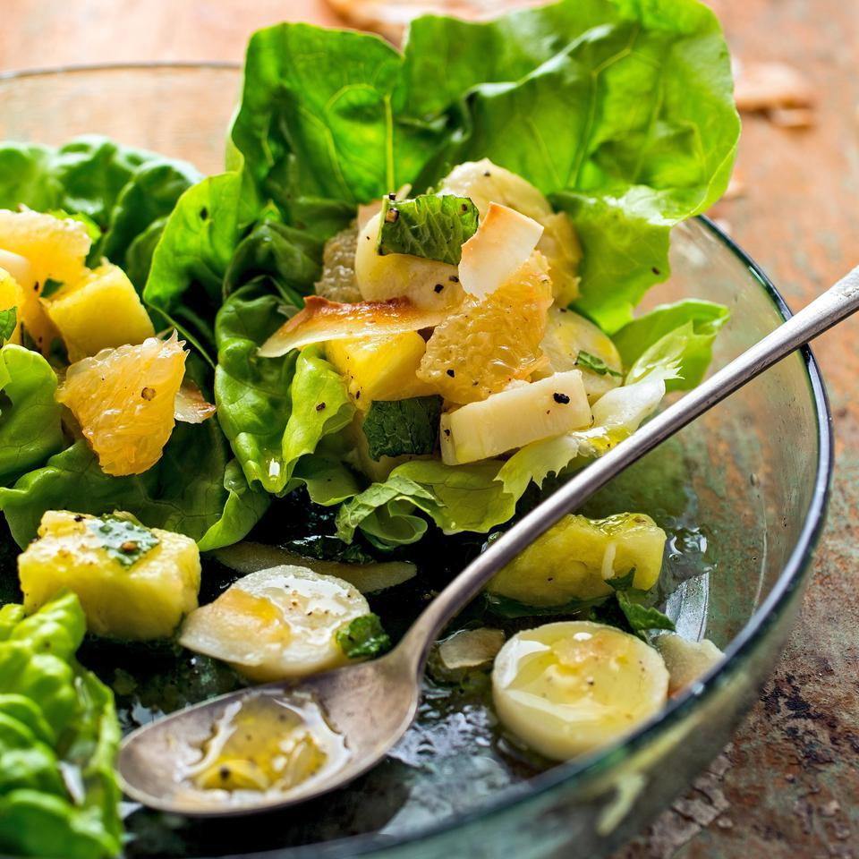In this healthy side salad recipe, hearts of palm bring balance to the flavors of this pleasantly sweet tropical fruit salad with pineapple, grapefruit and bananas. Serve alongside grilled chicken or coconut-crusted fish.