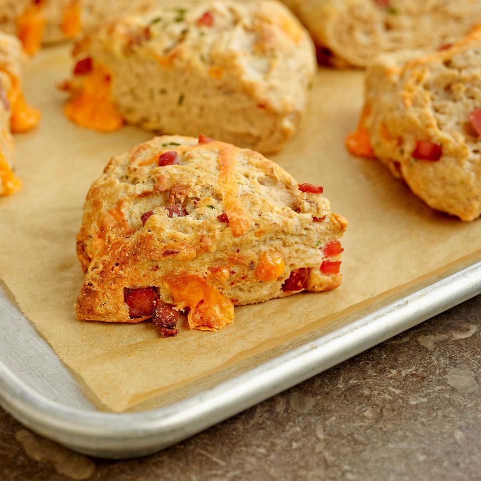 No baking degree required for this recipe: these healthy, savory ham-and-cheese scones are as easy to make as a batch of muffins. White whole-wheat flour adds a boost of fiber, and just enough butter gives them great flavor and texture without going overboard on calories. Try them with brunch or alongside your favorite stew.