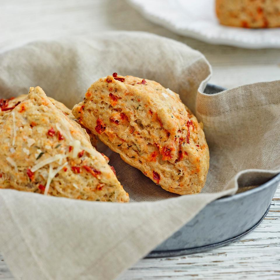 No bakery degree required for this recipe: these healthy, savory sun-dried tomato-and-Asiago scones are as easy to make as a batch of muffins. White whole-wheat flour adds a boost of fiber, and just enough butter gives them great flavor and texture without going overboard on calories. Try them with brunch or alongside your dinner salad. Source: EatingWell Magazine, March/April 2015