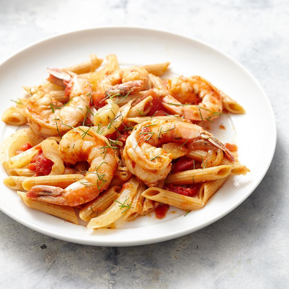 Sweet shrimp and fennel are just the thing to pair with spicy, garlicky tomato sauce in this healthy makeover of an Italian pasta recipe. If you're not a fan of heat, adjust the amount of crushed red pepper to taste. Serve with a green salad with a red-wine vinaigrette or sautéed green vegetables.