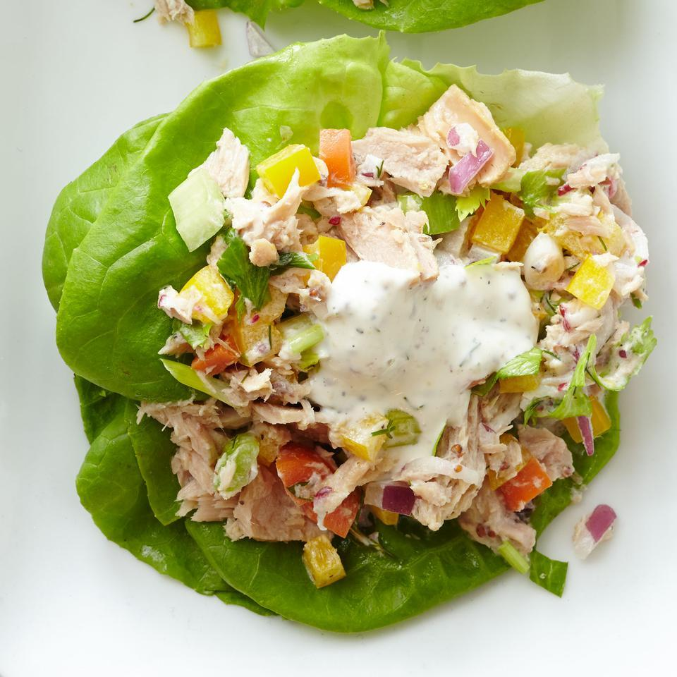The herb-infused dressing in this healthy tuna salad recipe calls for equal parts Greek yogurt and low-fat mayo to keep it light. Lots of fresh veggies, including bell pepper, carrot, radishes and celery, also give boosts of flavor, color and nutrients. Serve on lettuce leaves, over a green salad or as an open-face sandwich on whole-grain toast.