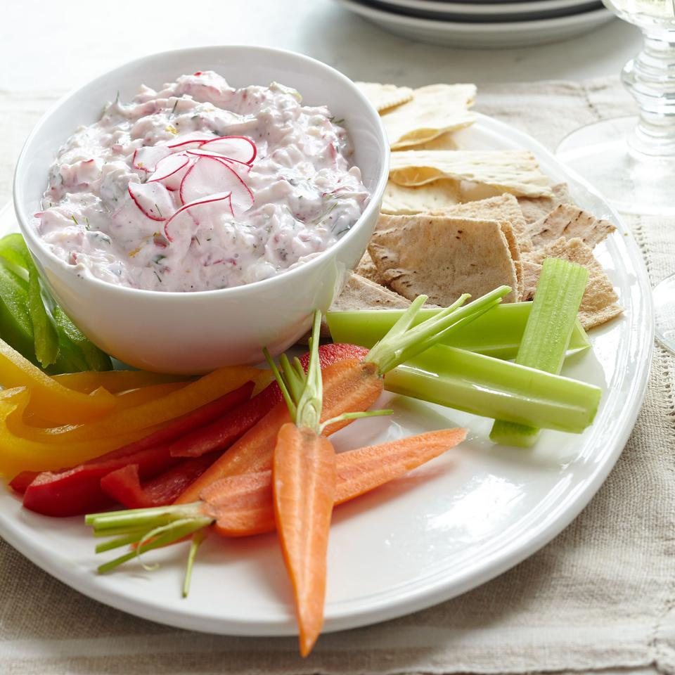 Thinly sliced radishes lend a peppery bite and pretty pink hue to this traditional Greek cucumber yogurt dip recipe. Serve the tzatziki as an appetizer with pita bread, lavash-style flatbread or vegetable crudités, or as a refreshing sauce with grilled fish or chicken.