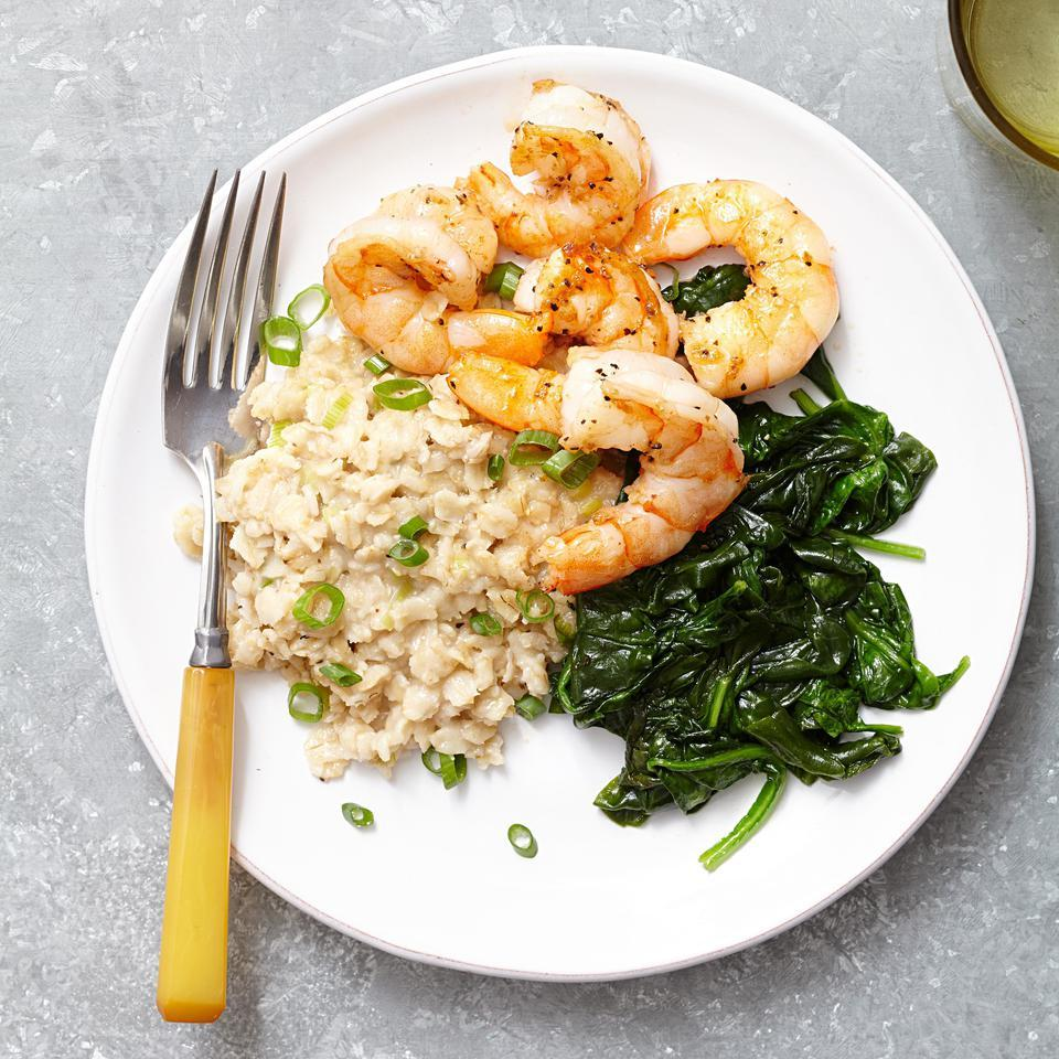 Oats are not just for breakfast! In this play on shrimp & grits, we simmered oats with scallions and cheese for a savory, creamy dish reminiscent of risotto. You'll even get your veggies with the sautéed baby spinach on the side. Serve with hot sauce and a glass of unoaked Chardonnay.
