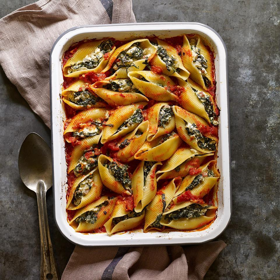 In this healthy stuffed shells recipe, tons of dark leafy chard replaces some of the cheese. Kale and/or collards are good substitutes for the chard as well. Serve with a salad with Italian vinaigrette.