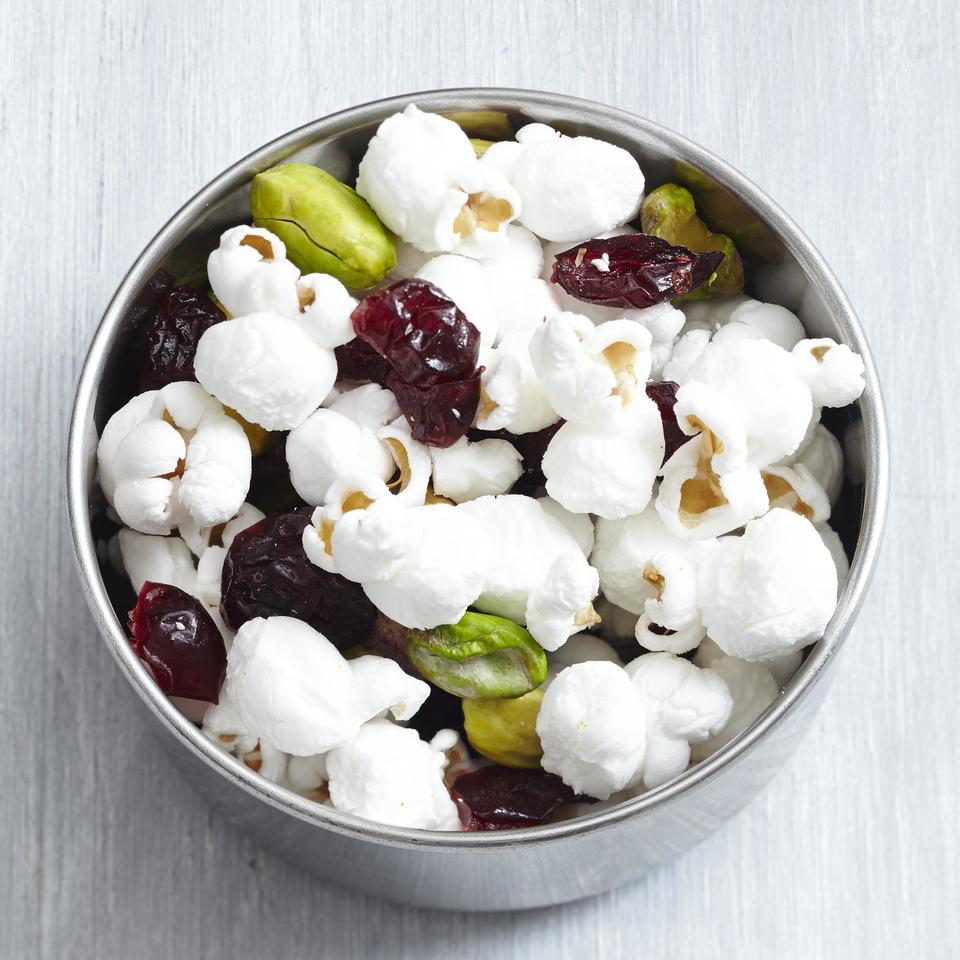 Sweet dried fruit, salty nuts and crunchy popcorn are mixed together to make this super-satisfying, homemade trail mix that travels well.