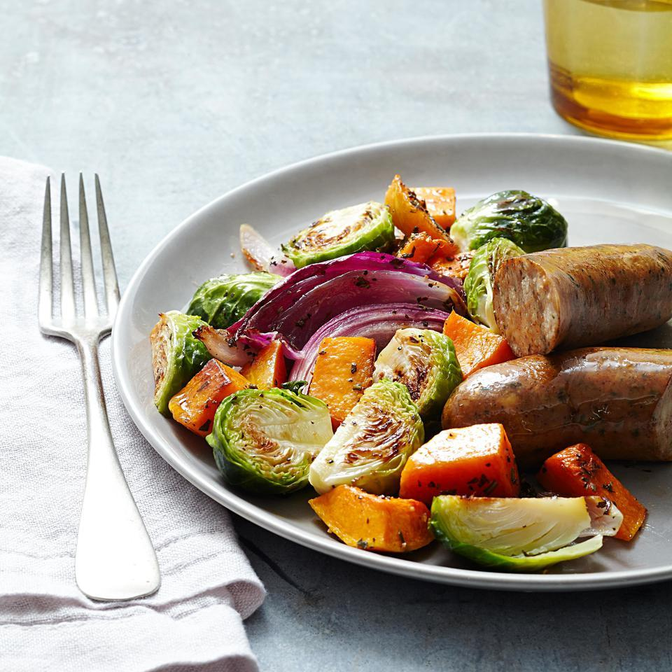 In this sheet-pan dinner recipe, butternut squash, Brussels sprouts, garlic and sausage all roast on one pan. Pick whatever variety of chicken sausage you prefer but we're partial to the flavor of chicken-apple in this healthy dinner recipe. Serve with crusty bread and a dollop of whole-grain mustard.