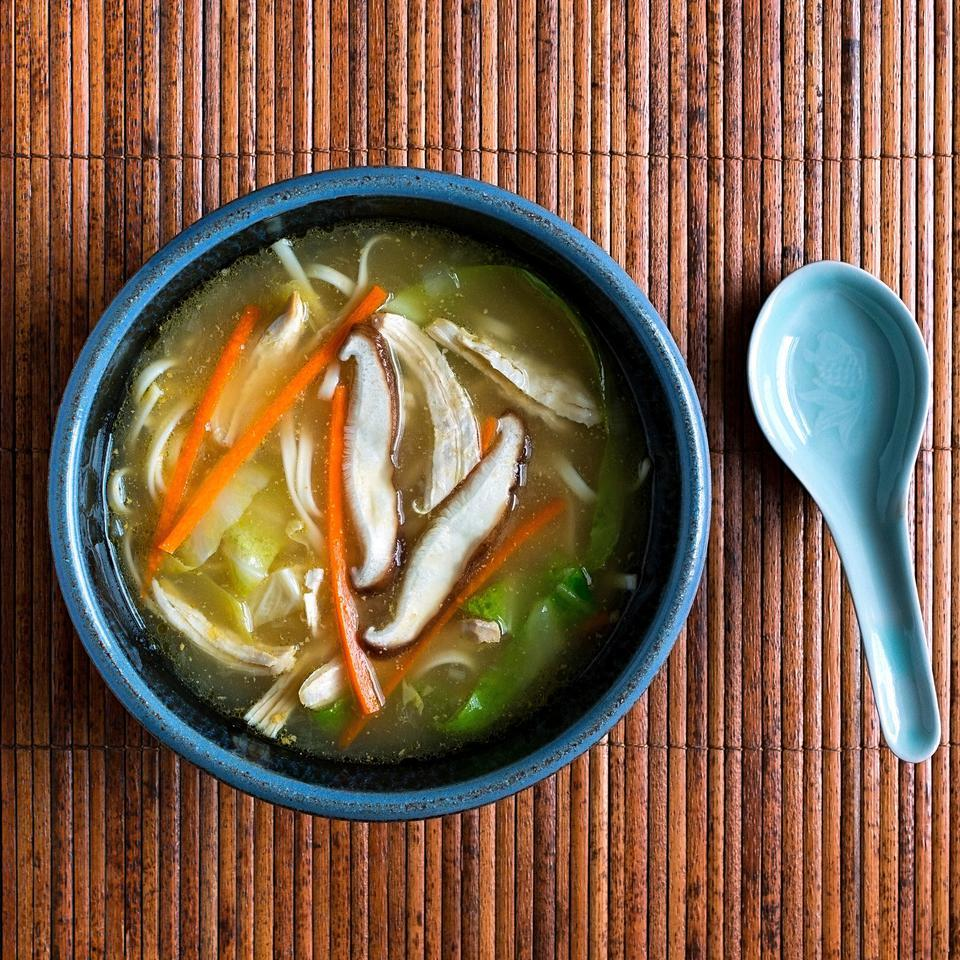 This healthy, Japanese-inspired chicken noodle soup recipe is made with udon noodles and gets a hit of umami flavor from a swirl of miso at the end. To make the miso easier to stir into the soup, combine a little bit of the hot broth with the thick miso to thin it before adding to the rest of the soup.