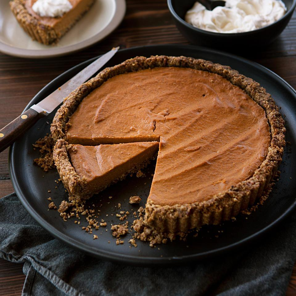 A pleasant tang, courtesy of Greek yogurt in the filling, and a mascarpone cheese whipped cream topping take this healthy pumpkin dessert recipe above and beyond classic pumpkin pie.