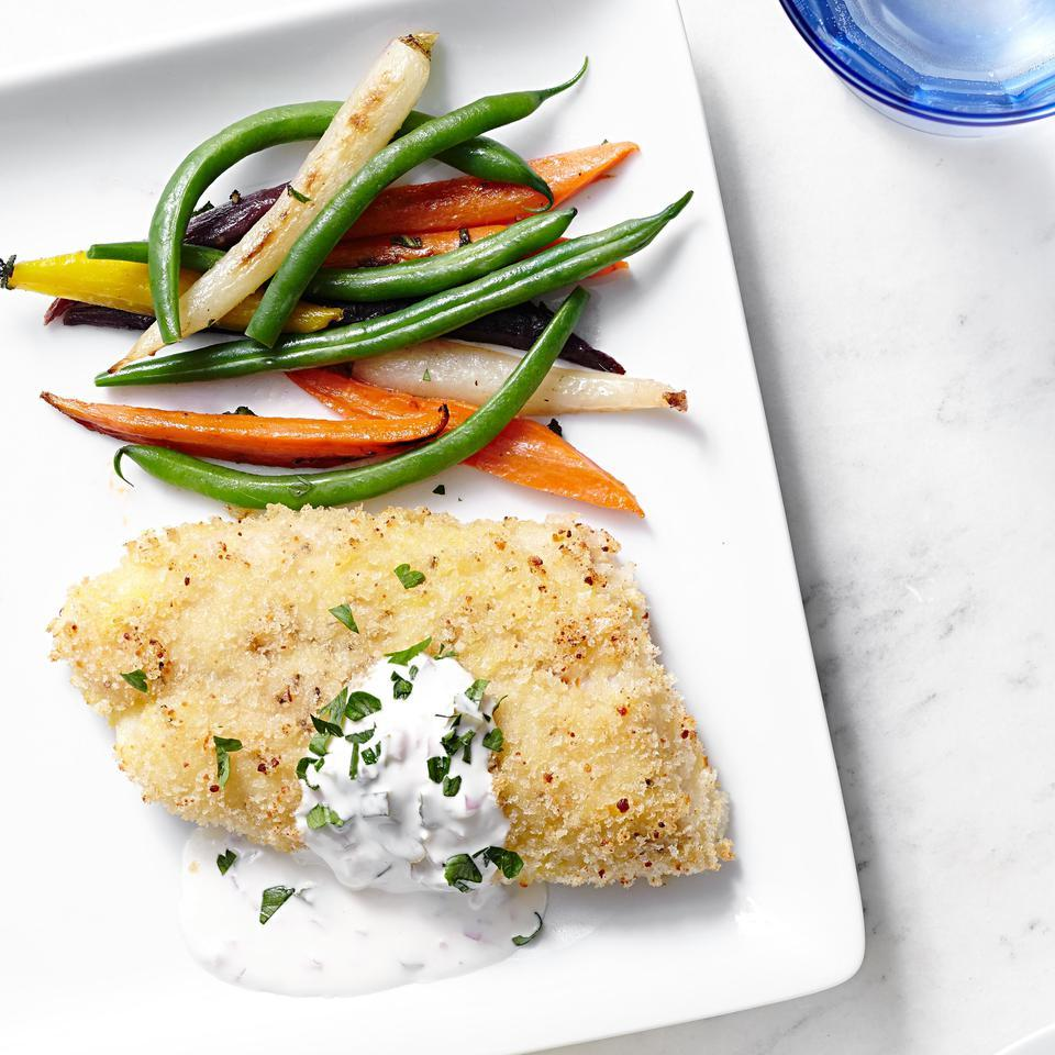 Panko breadcrumbs and Parmesan cheese give this healthy baked fish recipe delectable crunch for a healthy homemade alternative to fish sticks or fried fish. For the best taste, be sure to use olive oil or avocado oil cooking spray to coat the fish. Serve with roasted carrots and steamed green beans.