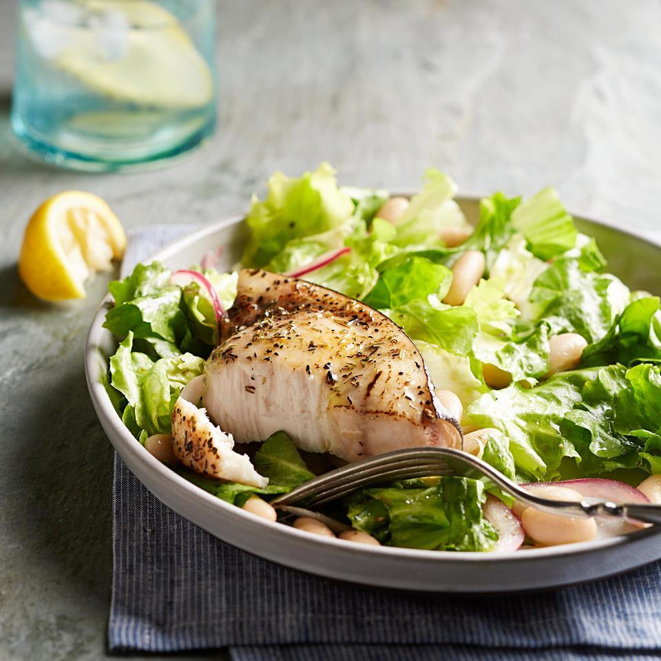 In this healthy fish recipe, meaty swordfish gets a dusting of herbs before being pan-seared. Then it's served on top of a healthy escarole and white bean salad with a lemon-Dijon vinaigrette.