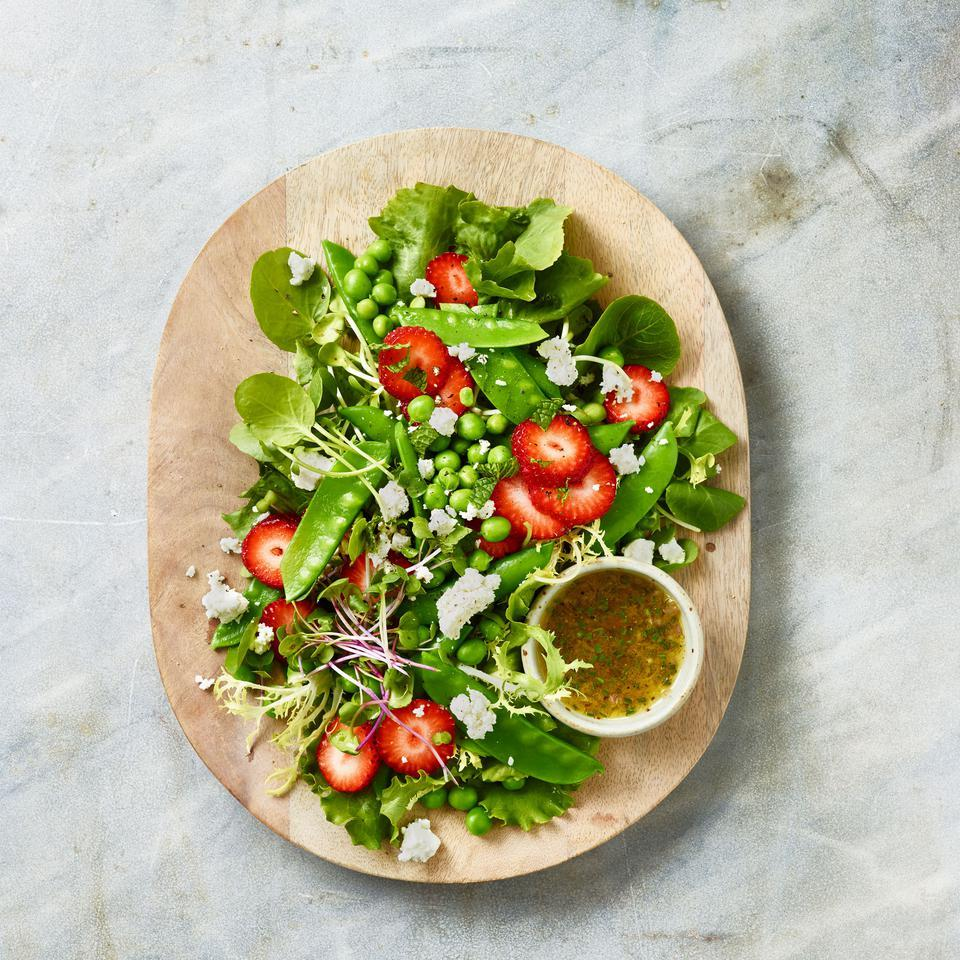 As delicious as it is beautiful, this spring pea salad recipe is a potluck or dinner party stunner. Assemble the salad and dress just before serving--or serve the dressing next to the salad for people to drizzle. The tangy champagne vinaigrette balances the grassy sweetness of the peas and fruity pop of the berries.