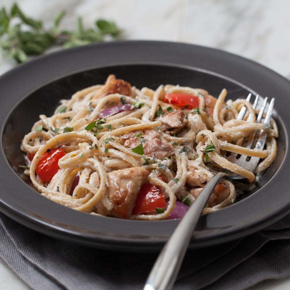 Yogurt seasoned with garlic and fresh herbs replaces cream to make a healthy pasta sauce in this chicken and vegetable pasta recipe. If you don't have a grill basket, the chicken and vegetables can be grilled on skewers instead. Source: EatingWell Magazine, May/June 2016