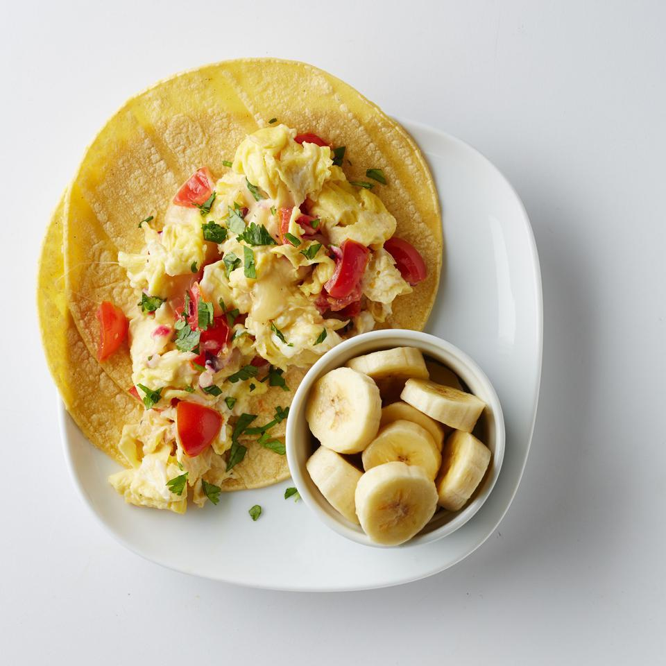 Breakfast tacos are a great gluten-free alternative to the classic eggs and toast. Serve this easy scrambled egg recipe with a banana for a boost of potassium. Source: EatingWell Magazine, May/June 2016