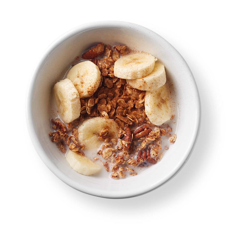 This quick and healthy granola recipe can be enjoyed like cereal with milk or sprinkled over yogurt to make an easy parfait. Serve with a banana for a balanced breakfast.Source: EatingWell Magazine, July/August 2016