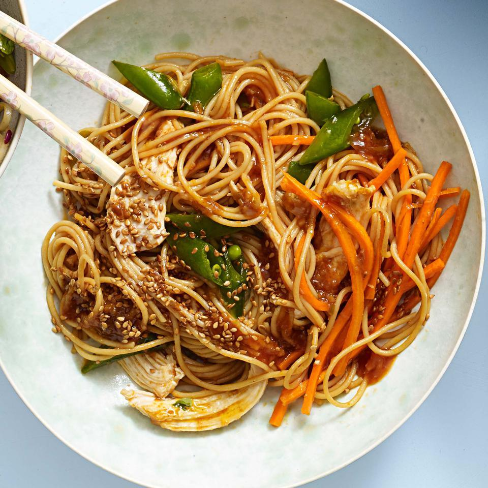 "Classic sesame noodles become a healthy meal with lean chicken and tons of veggies in this quick recipe for Asian noodles. Be sure to rinse the spaghetti until it's cold, then give it a good shake in the colander until it's well drained. Are you a spiralizing pro? Swap 5 cups of raw zucchini, carrot or other veggie ""noodles"" for the cooked pasta."