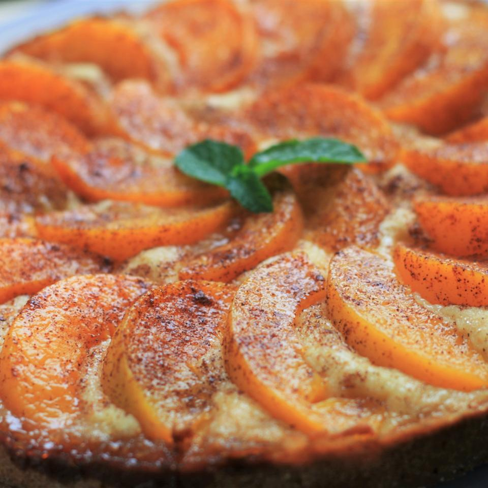 """Translation: peach cake. The recipe calls for margarine, but of course you can use butter instead. BakingLikeCrazy says, """"This was very good! I did use butter as that is what I had on hand. I also followed the suggestions and used almond extract. I'm so glad I did - I think the almond flavor really made this cake special. I also added an extra sprinkling of cinnamon to the topping and used turbinado sugar in lieu of the granulated sugar for the topping. Thanks! Very nice with coffee and not overly sweet."""""""