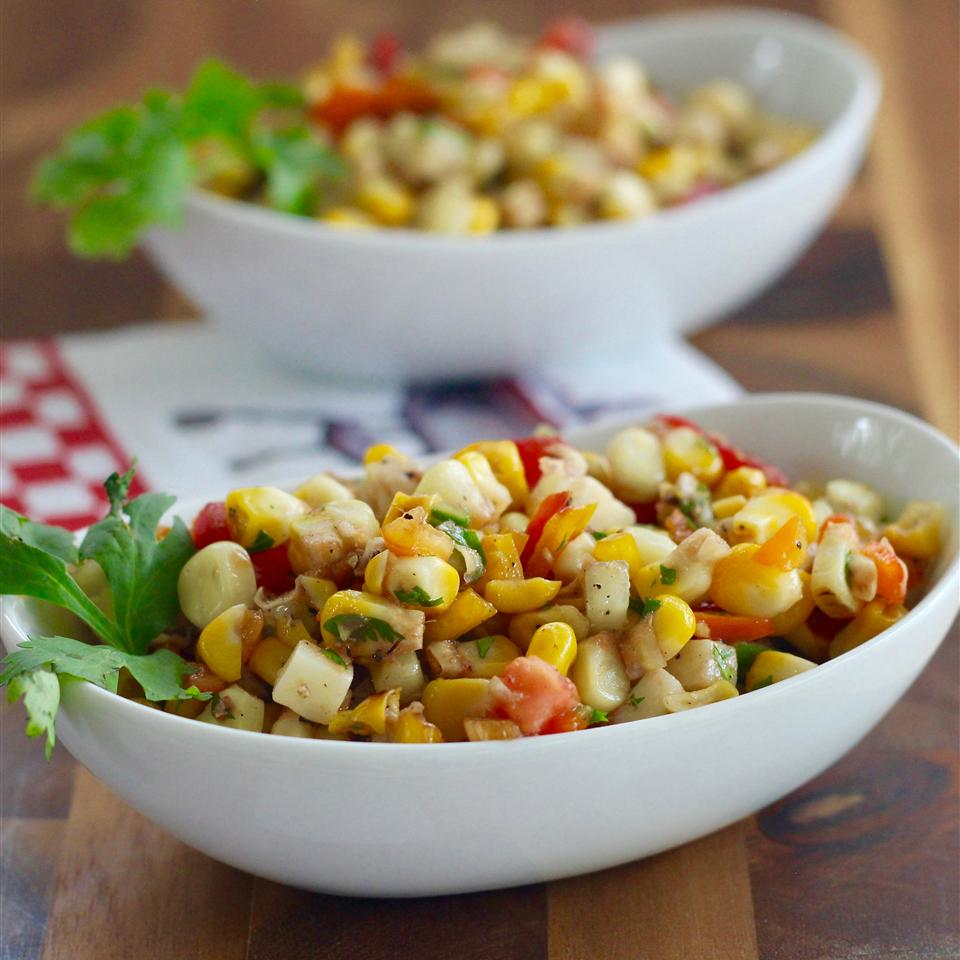 Grilled corn is tossed with tomatoes, bell peppers, cheese, cucumbers, and cilatro to make a bright and crunchy salad. Although the recipe says to boil the corn first, you know you can skip that step and just grill the corn, right?