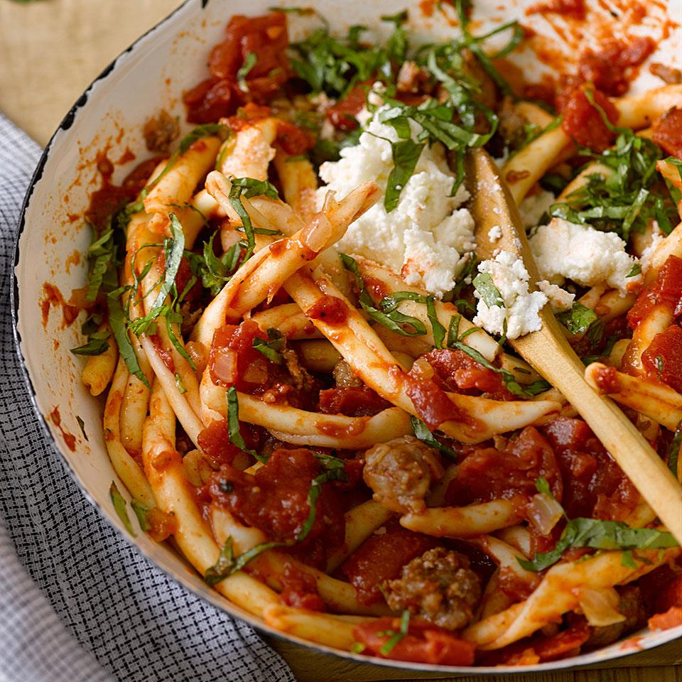 A bit of sausage goes a long way in flavoring the creamy ricotta tomato sauce in this healthy and quick pasta recipe. Serve with a green salad and crusty Italian bread.