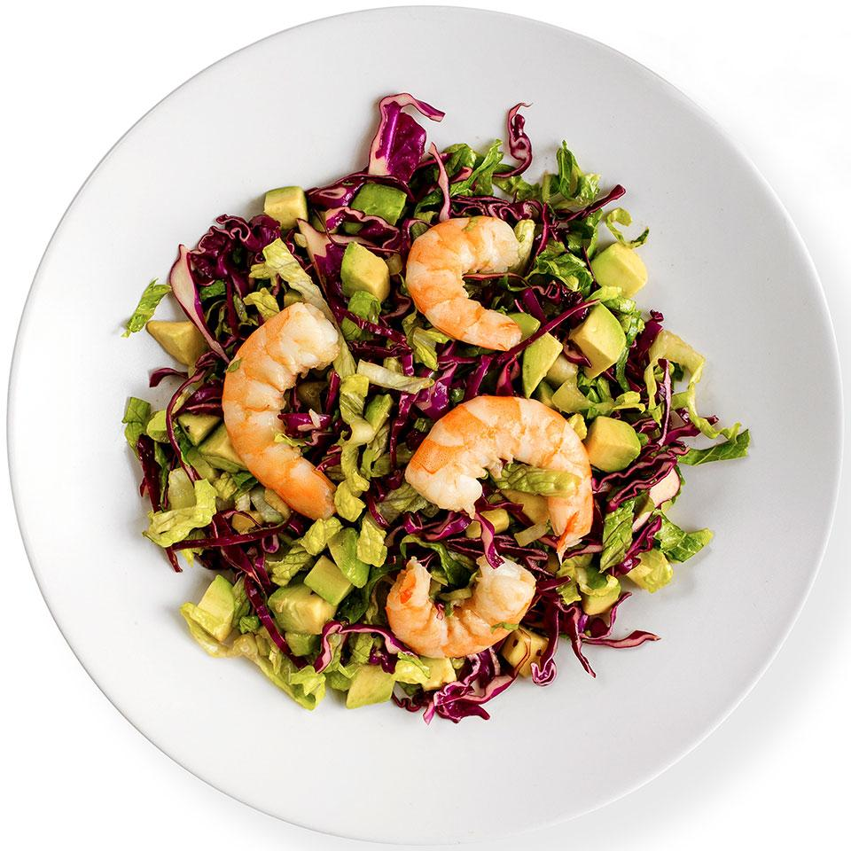 In this healthy Asian-inspired shrimp salad recipe, two types of greens--romaine lettuce and red cabbage--pair beautifully with the avocado and shrimp. Use extra dressing for another salad or as a sauce for baked fish.