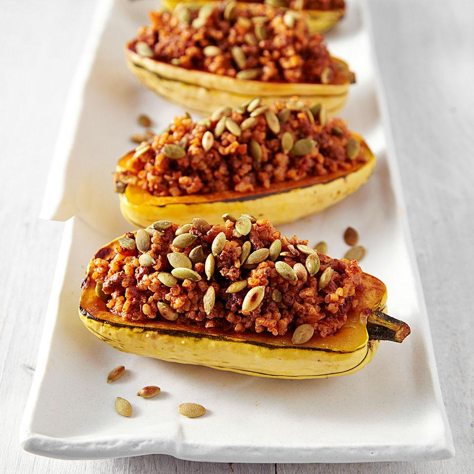 In this Tex-Mex-seasoned stuffed delicata squash recipe we swap out half of the ground beef you'd normally use for bulgur to reduce saturated fat without skimping on the amount of stuffing. Serve with a mixed green salad with cilantro vinaigrette.