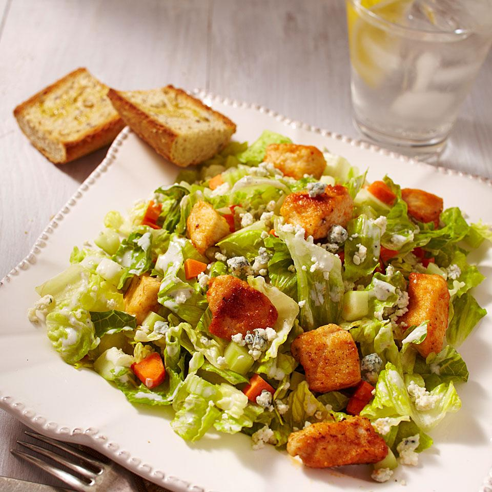 All the flavor of Buffalo chicken wings is packed into this irresistible, healthy salad. But unlike chicken wings, you can eat a big serving of this healthy Buffalo chicken salad recipe for just 291 calories.