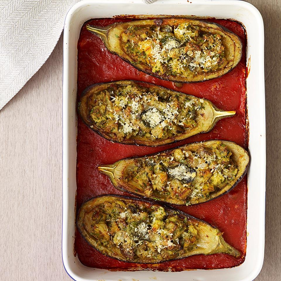 "In this Italian stuffed eggplant recipe, fresh breadcrumbs, Parmesan cheese and parsley make a simple, yet delicious filling for an ""inside-out"" eggplant Parmesan. Serve these stuffed eggplants as a light dinner along with a big salad. Source: EatingWell Magazine, September/October 2014"