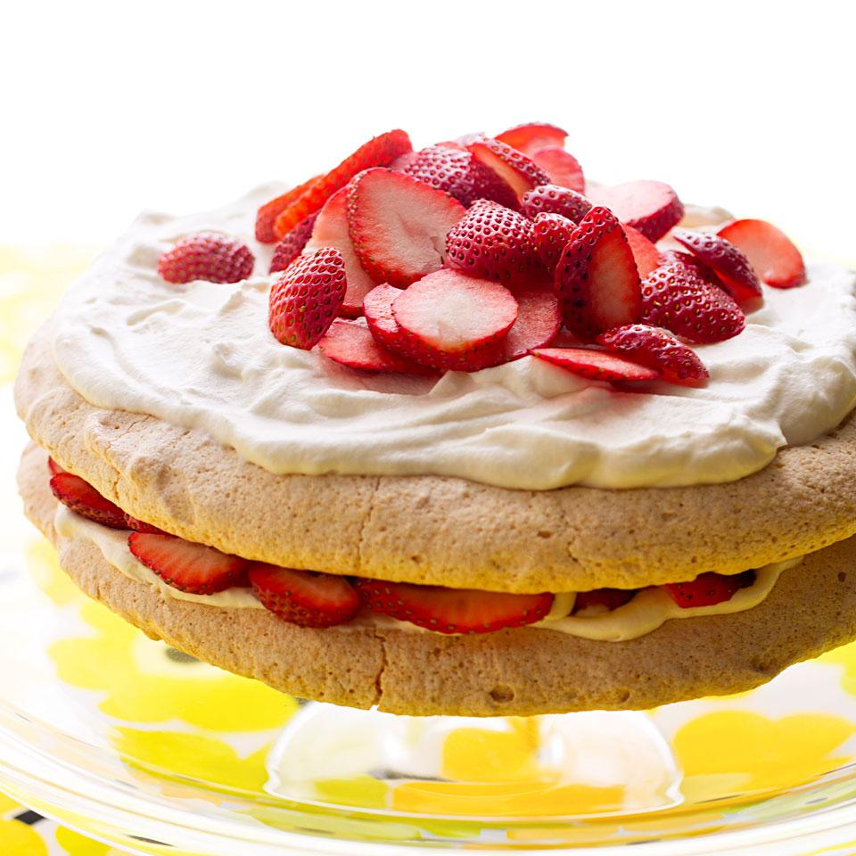 This light, flourless cake recipe features crispy, chewy rounds of almond meringue layered with strawberries and whipped cream. For the best results, avoid making the meringue layers on an overly humid or rainy day. The moisture prevents proper crisping.