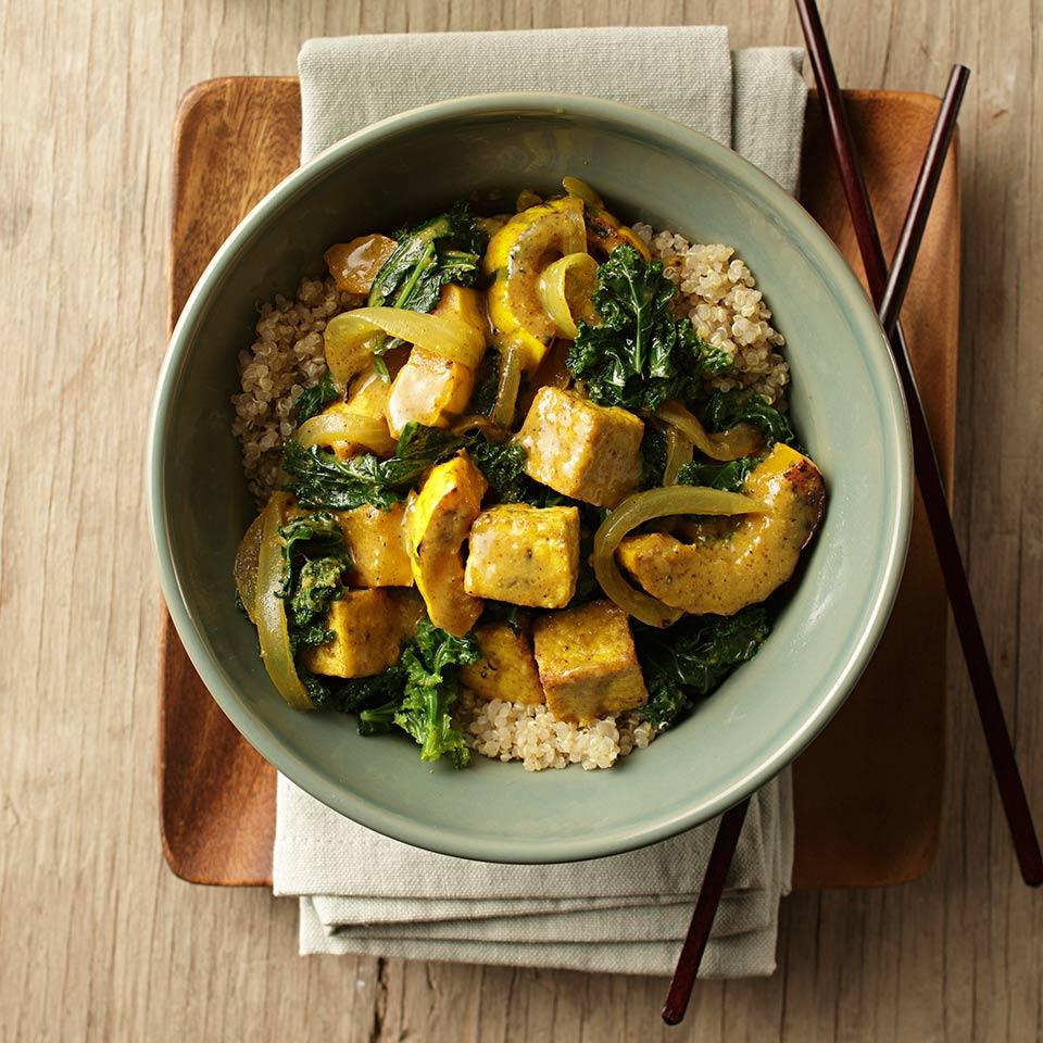 This easy tofu curry, made with pretty delicata squash and hearty greens, cooks up in one skillet. To speed up the prep, use bagged chopped kale. Delicata squash's thin skin is tender when it's cooked, so there's no need to peel--another time saver. Serve with quinoa or brown rice.