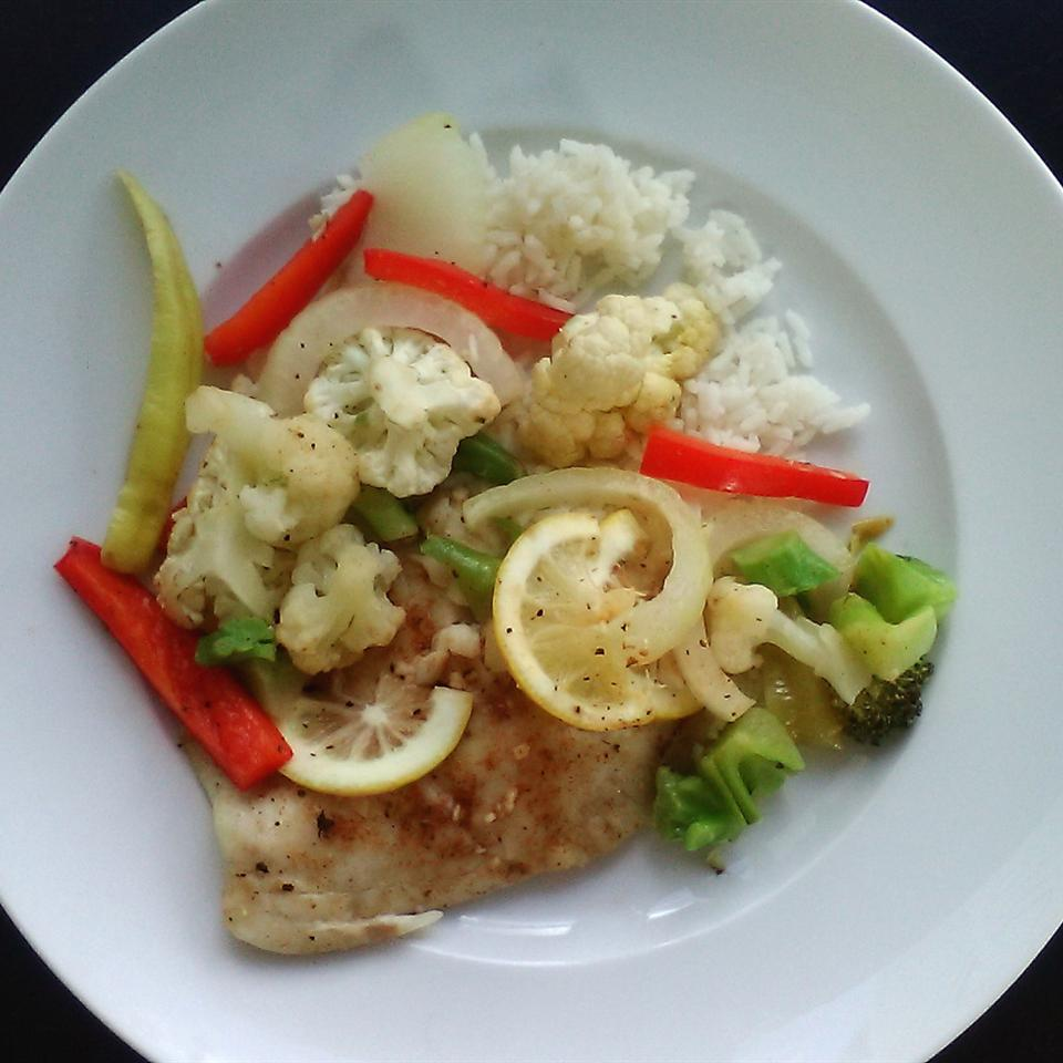 "Fresh garlic and lemon do wonders in this quick-and-easy baked tilapia dinner. ""This recipe only takes a few minutes to prepare, uses few ingredients, and is flavorful,"" says MakeItHealthy. Serve with cauliflower, broccoli, and red pepper, and you have a healthy and satisfying meal."