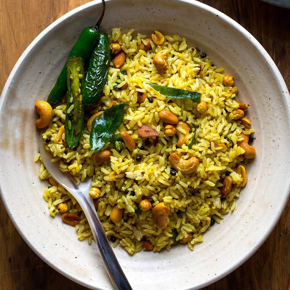 Use up leftover rice and make it into something delicious with this healthy Indian recipe. Because cooked rice refrigerated overnight dries out a little, it's better suited to absorb all the flavors in this dish without getting sticky or mushy. In a pinch, use frozen or shelf-stable precooked basmati rice, available in many stores. Urad dal and roasted chana dal add texture and authenticity to the rice--look for both types of dal in Indian markets or online.