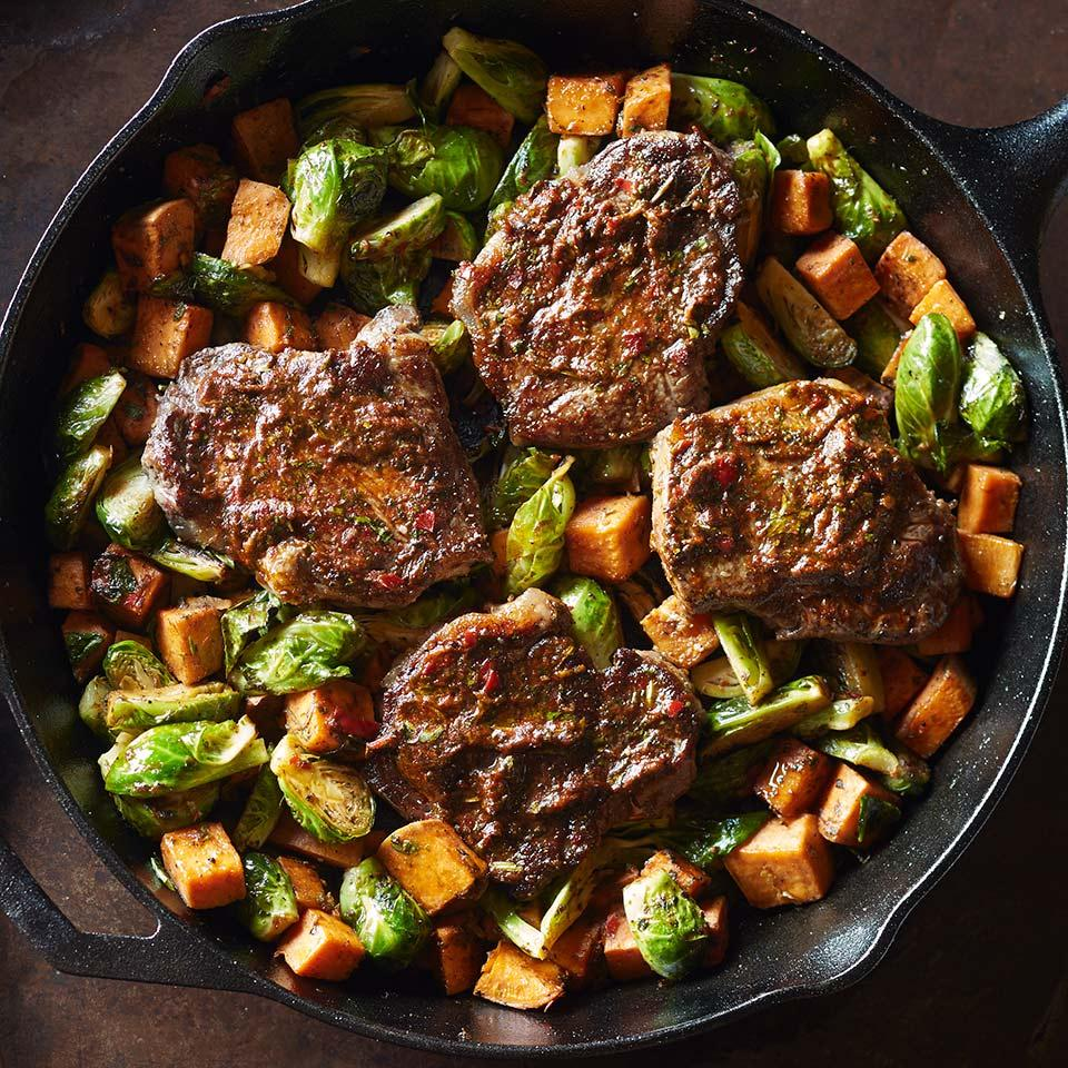 In this healthy dinner recipe, a cast-iron pan does double duty by searing the steaks and roasting the vegetables. Not a fan of cilantro? The sauce is great with parsley instead.